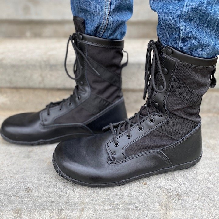 a close up of a pair of men's feet wearing the Belleville mini mil in black